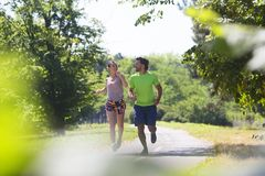 Healthy, fit and  sportive couple running in park Royalty Free Stock Images