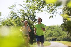 Healthy, fit and  sportive couple running in park Stock Images