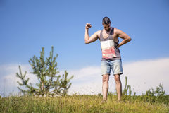 Healthy fit sportsman training and showing off his muscles. Healthy fit sportsman flexing his arms and training showing off his muscles stock photography