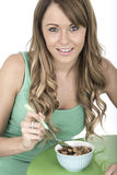 Healthy Fit Young Woman Eating Bowl of Breakfast Cereals Royalty Free Stock Images