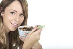 Healthy Fit Young Woman Eating Breakfast Cereals Stock Photo