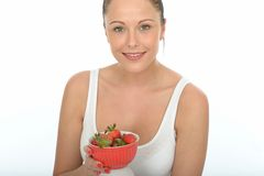 Healthy Fit Young Woman Holding a Bowl of Fresh Ripe Juicy Strawberries Stock Photos