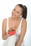 Healthy Fit Young Woman Holding a Bowl of Fresh Ripe Juicy Strawberries Royalty Free Stock Image