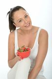 Healthy Fit Young Woman Holding a Bowl of Fresh Ripe Strawberries Stock Photography