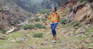 Healthy fit young woman outdoors backpacking Royalty Free Stock Images