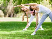 Young women exercising in the park. Healthy and fit young women doing fitness and Exercise in the park Royalty Free Stock Image