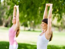 Young women exercising in the park. Healthy and fit young women doing fitness and Exercise in the park Stock Photos