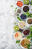 Healthy fitness food from fresh fruits, berries, greens, super food: kinoa, chia seeds, flax seed, strawberry, blueberry. Kiwi, cherry, almonds, walnuts, mint Royalty Free Stock Images