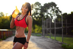 Healthy fitness girl with protein shake. Royalty Free Stock Photo