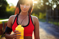 Healthy fitness girl with protein shake. Smile sport woman in the sunny day Royalty Free Stock Photography