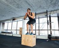 Healthy fitness guy doing exercise with a wooden stand. Healthy fitness guy doing exercise with a fit box in a gym Stock Photography