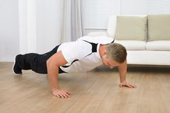 Healthy fitness man doing pushups Royalty Free Stock Image