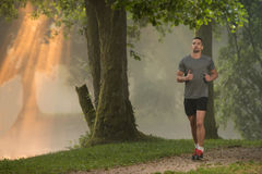 Healthy Fitness Man Jogging Outdoors Stock Photos