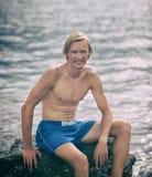 Healthy fitness man near the sea stock photo