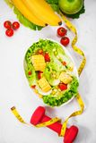 Healthy fitness meal with fresh salad. Diet concept. Stock Photo
