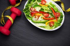 Healthy fitness meal with fresh salad. Diet concept. Stock Photos
