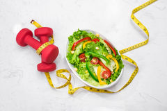 Healthy fitness meal with fresh salad. Diet concept. Stock Images