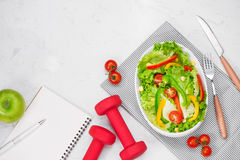 Healthy fitness meal with fresh salad. Diet concept. Stock Image
