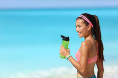 Healthy fitness runner girl drinking water bottle. Healthy fitness runner girl drinking water from plastic bottle on running break. Young Asian woman happy on royalty free stock photos