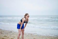 Healthy fitness runner girl exhausted on running break Stock Images