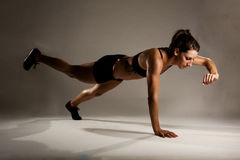Healthy Fitness Woman doing a One Handed Pushup