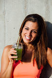 Healthy fitness woman drinking detox smoothie Stock Image