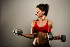 Healthy Fitness Woman Flexing Her Muscles stock photo