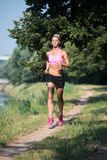Healthy Fitness Woman Jogging Outdoors Stock Photo
