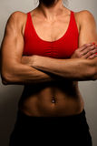 Healthy Fitness Woman Showing Her Muscles royalty free stock photo