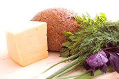 Healthy food. Ray bread, cheese and herbs on the white background royalty free stock photo