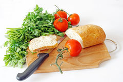 Healthy food. Vegetables and bread Royalty Free Stock Photo