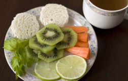 Healthy food. Plate with healthy food and cup of tea Royalty Free Stock Images