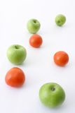 Healthy Food. Green apples and tomatoes on white background Stock Images