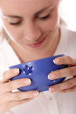 Healthy food. Stock photo of a young woman holding blue bowl (with soup; healthy eating royalty free stock photography