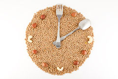 While healthy food. Healthy food, Hours of beans and nuts, time nutrition, Hours of lentils, concept of proper nutrition, healthy living, theory of healthy food Royalty Free Stock Photography