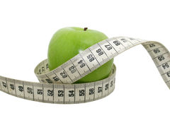 Healthy food. An apple with a measuring tape Stock Image