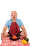 Healthy food. Overweight man looking very unhappy with a plate with a pepper on it royalty free stock photos