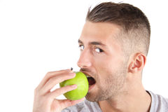 Healthy Food. A handsome man eating an apple. All isolated on white background Stock Images