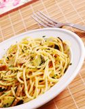 Healthy food. Pasta with tuna fish and zucchini Royalty Free Stock Image