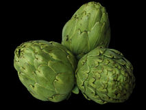 Healthy food. Isolated artichokes on black background stock photography
