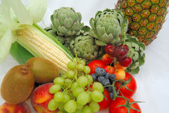 Healthy Food. Assortment of fruits and vegetables are part of a healthy lifestyle. These include Artichoke, tomatoes, fresh corn, grapes, blueberry, cherries Stock Image