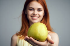 Healthy food, apple, food, diet, woman with apple on gray background Royalty Free Stock Images