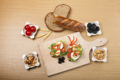 Healthy Food. Arrangement of different types of healthy and organic food on the wooden board and wooden background Royalty Free Stock Image