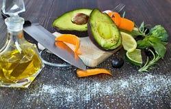 Healthy food avocado, carrots and broccoli. Healthy food avocado, carrots and broccoli flavored with lemon, salt, basil, rosemary and olive oil Stock Image