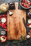 Healthy food background with aged cutting board,  cooking pot ,vegetables and kitchen knife, top view Royalty Free Stock Photography