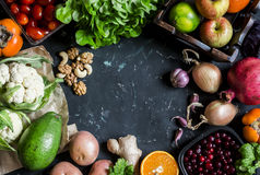 Healthy food background. Assortment of fresh vegetables and fruits on a dark background. Free space for text, top view. Royalty Free Stock Photos