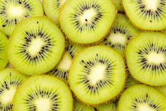 Healthy food background with beautiful green kiwi Stock Images