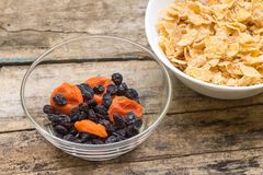 Healthy food background. Corn flakes with dried fruits Royalty Free Stock Photo