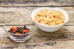 Healthy food background. Corn flakes with dried fruits Stock Image