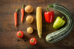 Healthy food background .Different vegetables on old wooden tabl. Healthy food background . studio photography of different vegetables on old wooden table Stock Photo